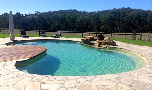 Freefrom lagoon pool in Warrandyte with rock feature and infloor cleaning