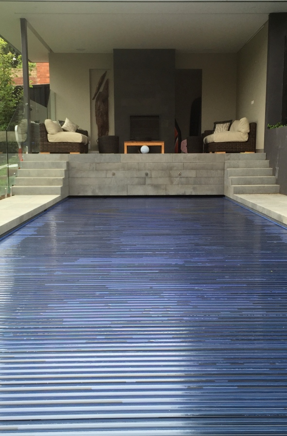 Glass tiles pool with solid Swimroll pool safety cover