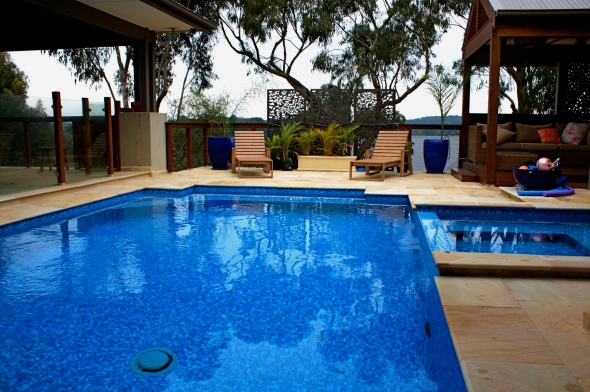 Fully tiled pool and spa built 2.5 meters out of ground. Infloor cleaning and glass tile.