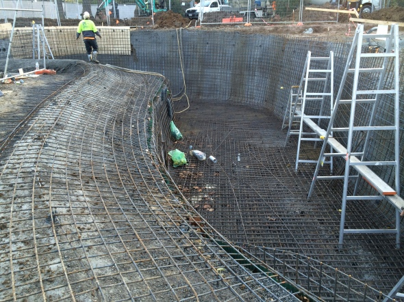 freeform pool with 4meter high wet feature wall during construction