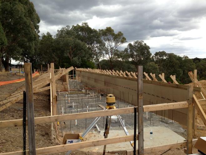 25m lap pool built above ground on strip footings